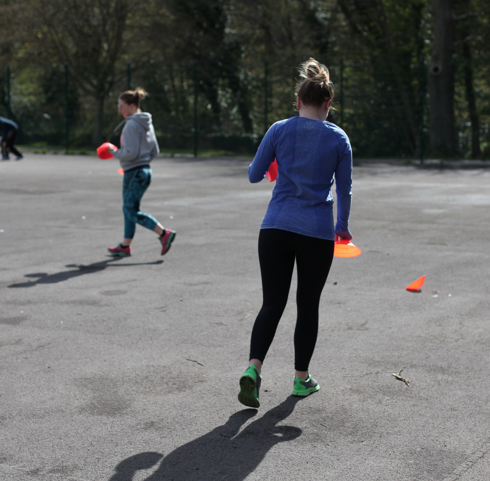 A client running with cones