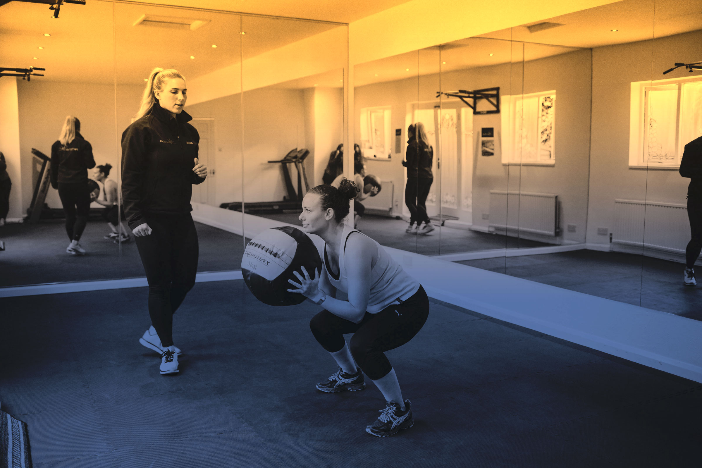 Phoebe's client lifting a medicine ball